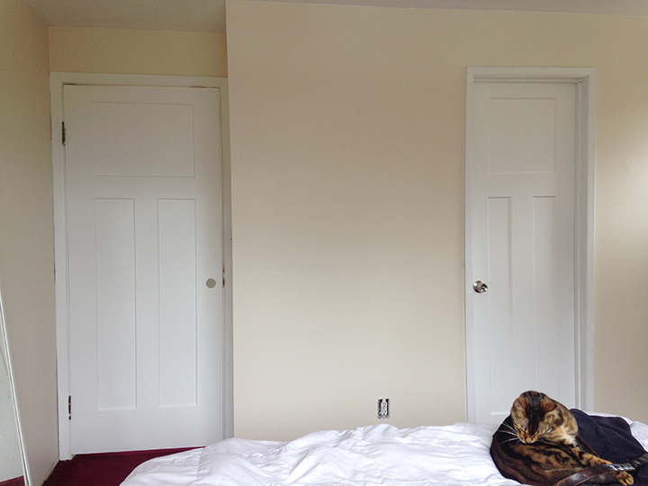 Master bedroom with new paint, painted trim, new doors.