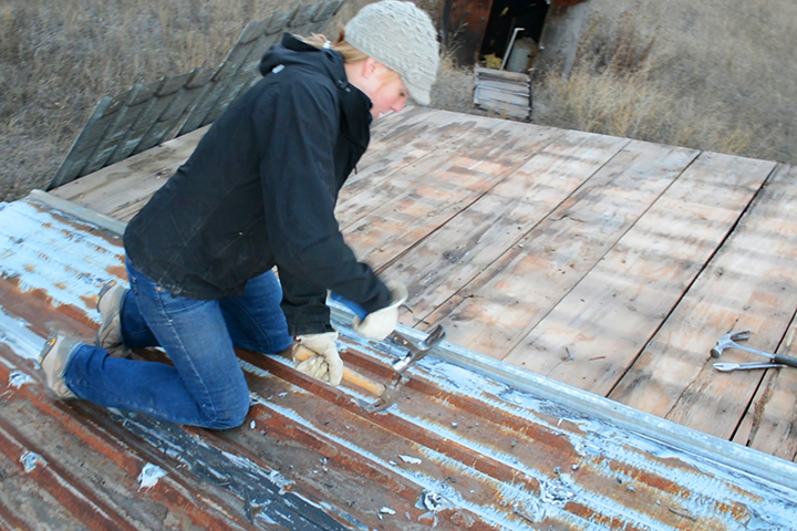 taking apart roofing - reclaimed building materials
