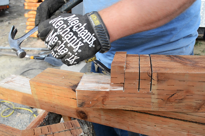 Jesse practicing his timber framing joinery skills on a different small project. This skill is necessary for the building of our timber frame barn.