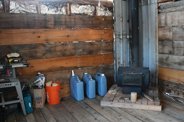 The corner of our cabin where we keep the wood stove. We put things by the stove to keep them from freezing (like water!).