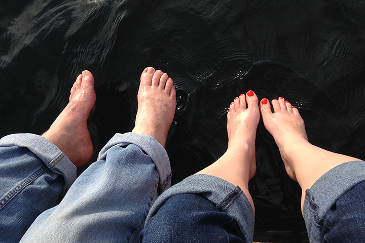 Dipping our toes into a cool, Idaho lake on a warm summer day.