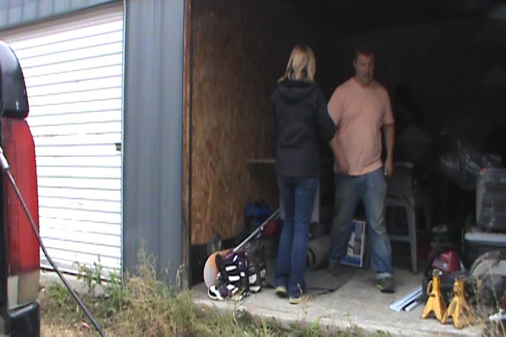 Unloading our belongings at a storage unit so that we could access the trailer.
