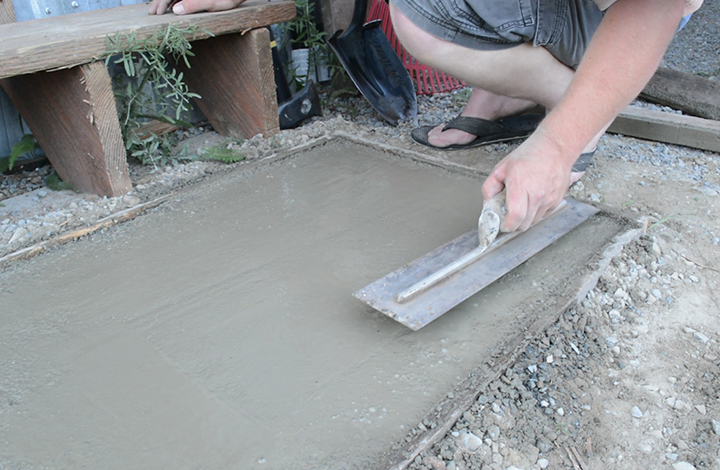 smoothing the concrete slab